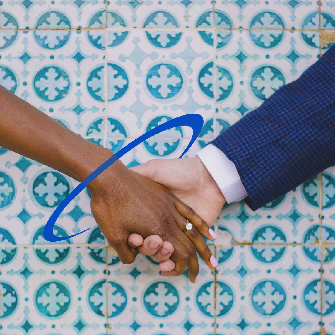 Married couple holding hands over blue decorative tile